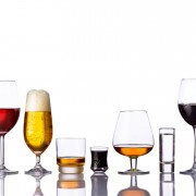 alcoholic drinks in a row isolated on white background